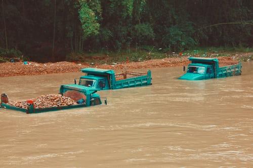 trucks in flood