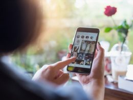 one girl checks the android instagram clone on mobile.